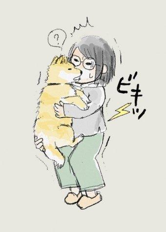 大五郎を抱きかかえて腰痛に